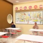 Área destinada a refeições e convivência com possibilidade de jogos e terapia ocupacional